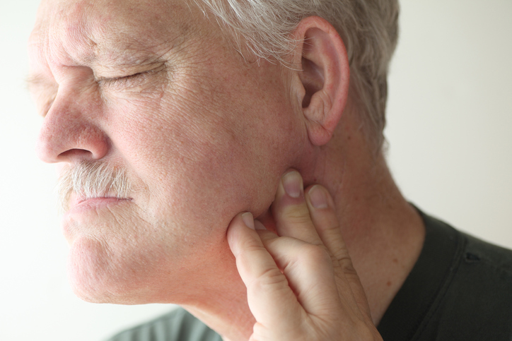 Man in pain with TMJ